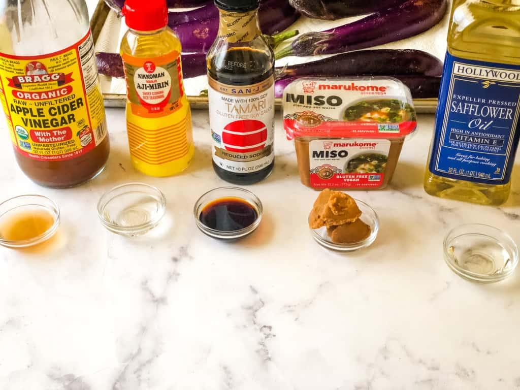 Ingredients for the miso glaze including apple cider vinegar, mirin, tamari, miso paste, and safflower oil