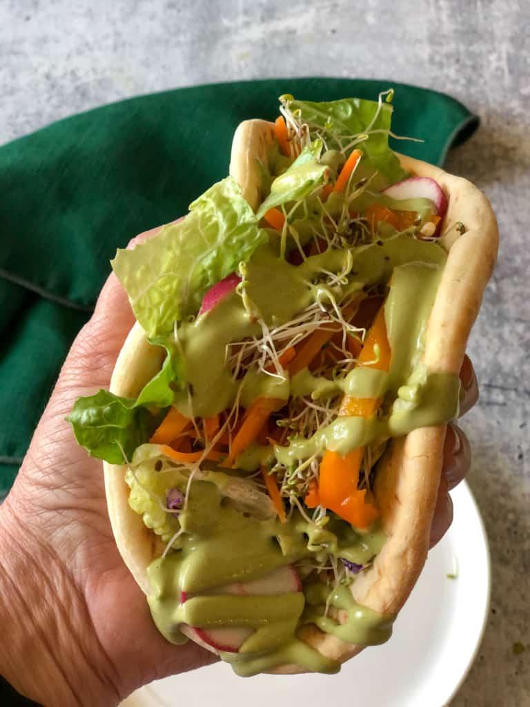 creamy basil dressing drizzled on a sandwich
