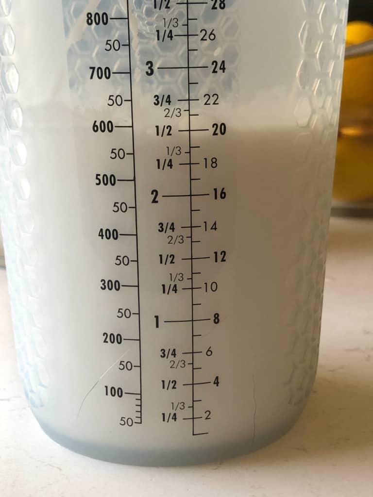 measuring container showing coconut milk