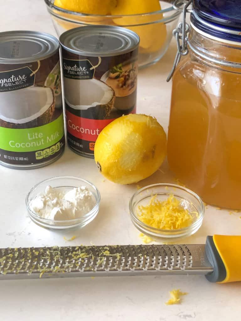 Ingredients for lemon ice cream including coconut milk, lemonade concentrate, cornstarch, and lemon zest