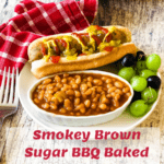 baked beans with vegan hotdog and grades on a plate with pinterest text overlay