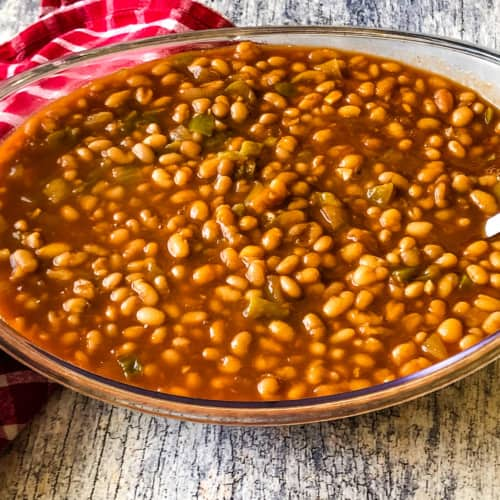 clear serving bowl of BBQ baked beans