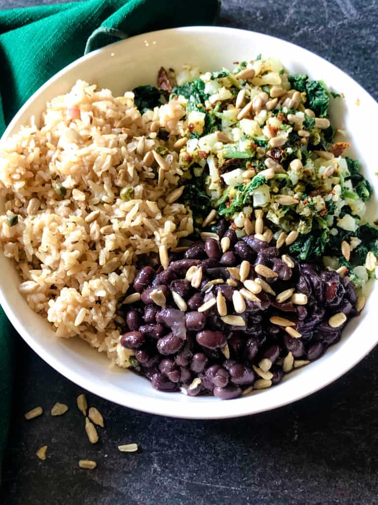 Buddha bowl with lemon herbed brown rice, cuban black beans, and a veggie mix