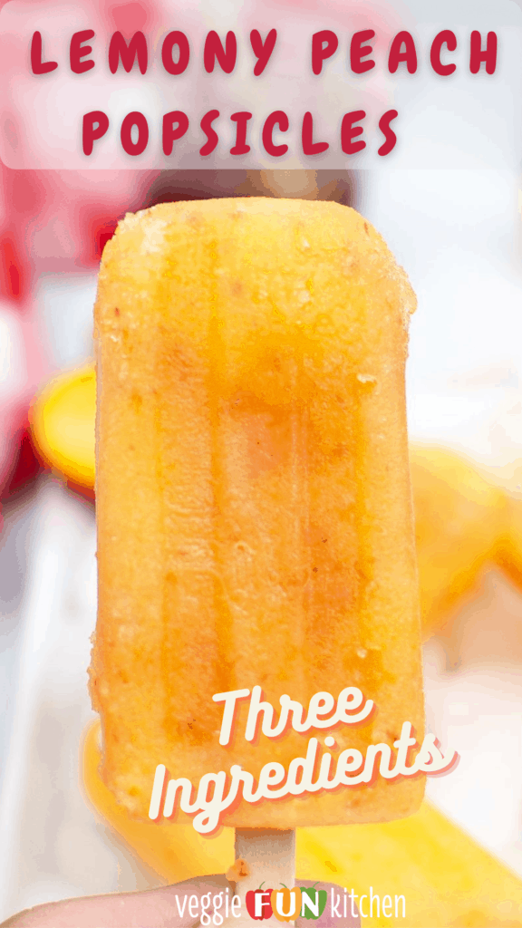 frozen peach popsicle held in hand with red checked napkin in background with pinterest text overlay