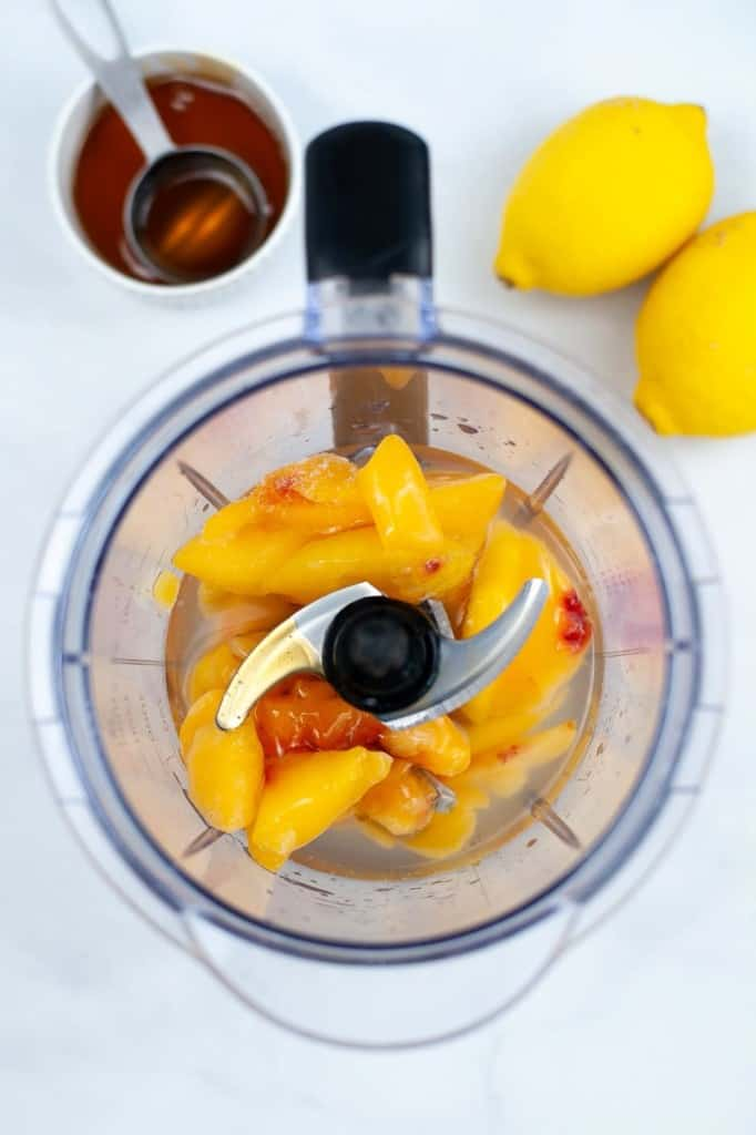 blending the peaches, agave, and lemon juice