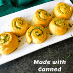 pesto dinner rolls on a white tray with pinterest text overlay