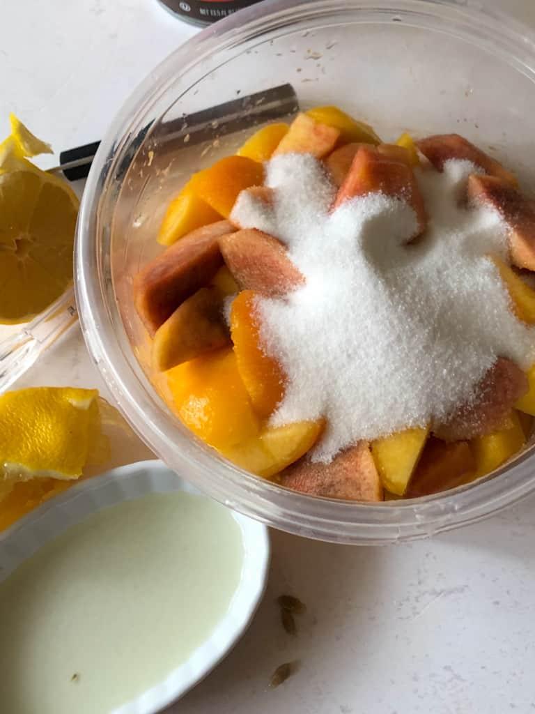 showing sugar on cut peaches