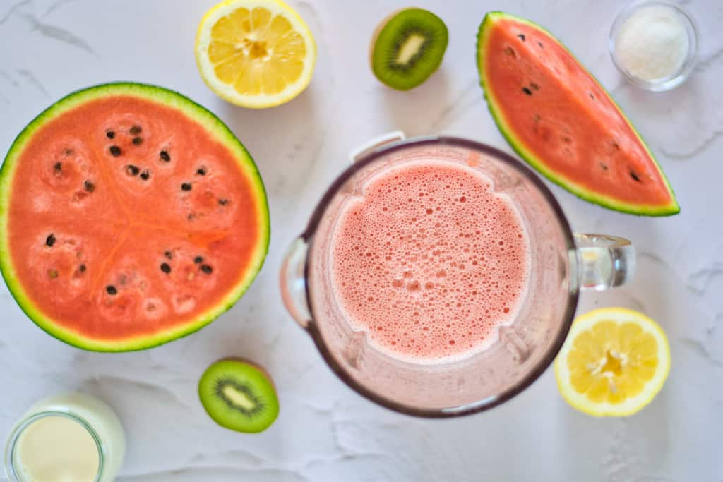 blended watermelon watermelon, lemon, kiwi, coconut milk, and monk fruit surrounding the blender