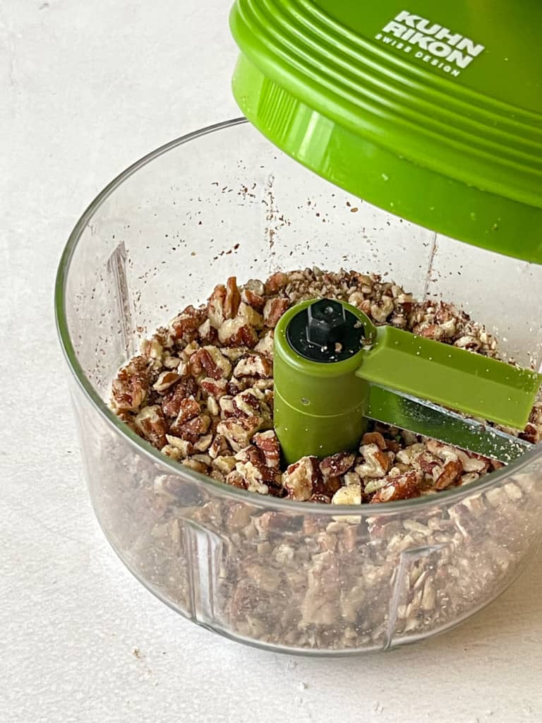 chopped pecans in chopping device