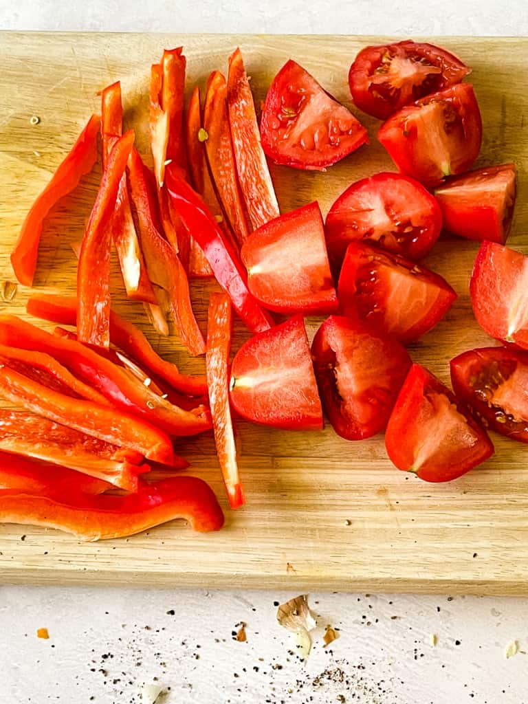 sliced bell peppers and quarters tomatoes