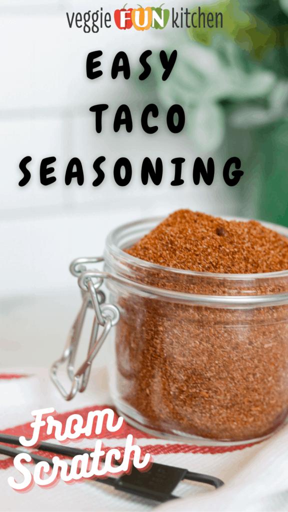 glass jar of homemade taco seasoning with pinterest text overlay