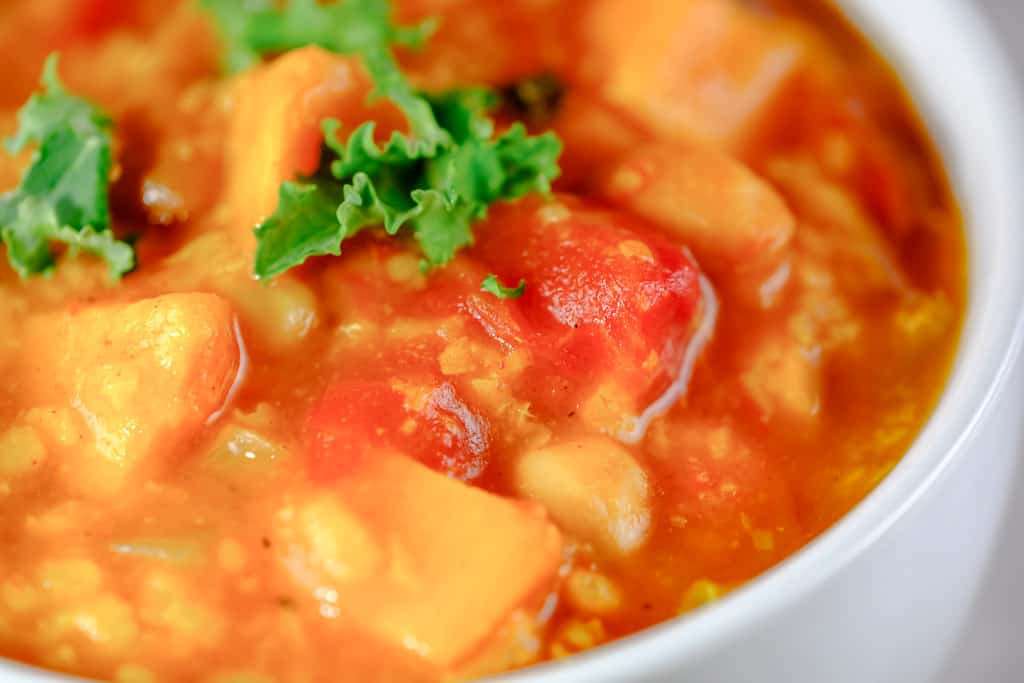close up of sweet potato stew in a bowl